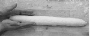photo of hands shaping a baguette